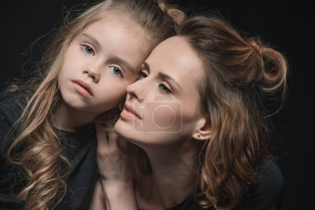 Photo for Portrait of stylish daughter and mother  isolated on black - Royalty Free Image