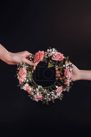 hands holding wreath