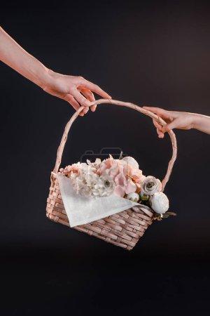 hands holding basket