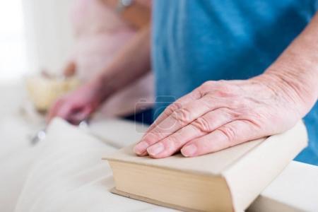 hand lying on book