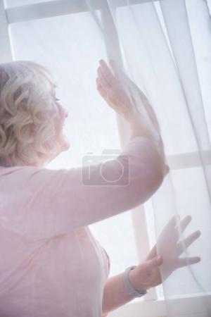 Senior woman at window