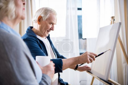 Senior couple painting