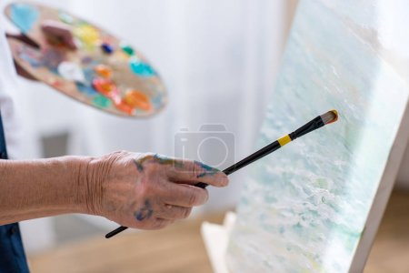 Photo for Partial view of senior man drawing picture in workshop - Royalty Free Image