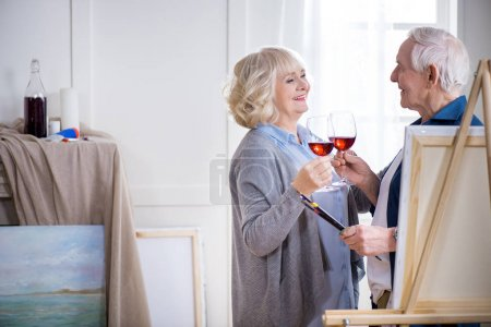 Senior couple with glasses of wine