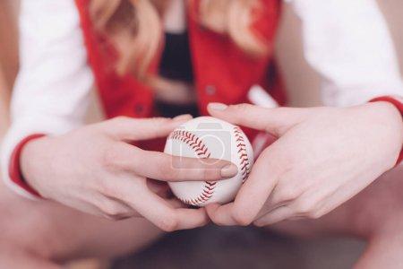Woman holding baseball ball