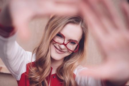 Woman making focus framing gesture