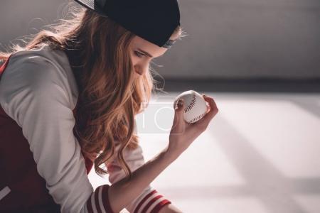 Young woman with baseball ball