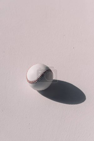 Photo for Close-up top view of baseball ball with shadow on grey background - Royalty Free Image