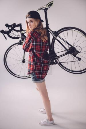 Photo for Side view of stylish woman holding sports bicycle - Royalty Free Image