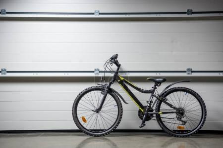 Photo for Mountain bike standing indoors at grey wall - Royalty Free Image