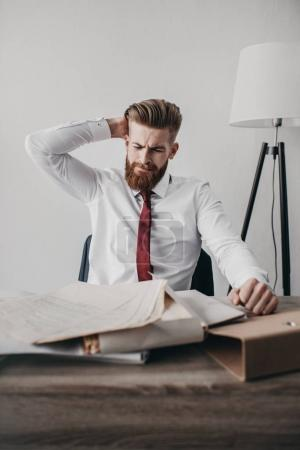 stressed businessman with documents