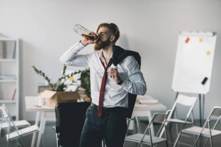 Drunk businessman in office