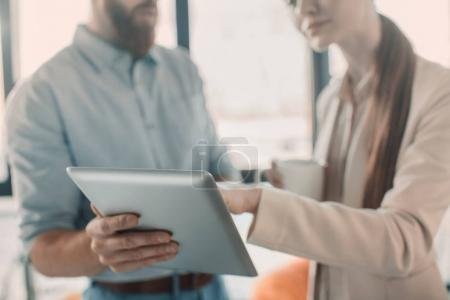 Photo for Cropped shot of young businessman and businesswoman using digital tablet - Royalty Free Image