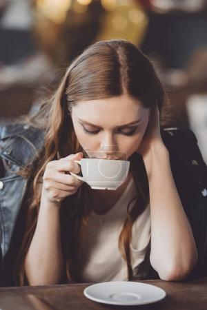 Photo for Attractive woman drinking coffee after party at home - Royalty Free Image