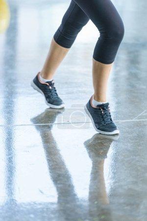 sportswoman in sportswear and sneakers