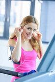 Sporty woman in earphones