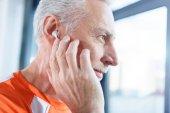 Mature man in earphones