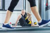 Mature sportsman in gym