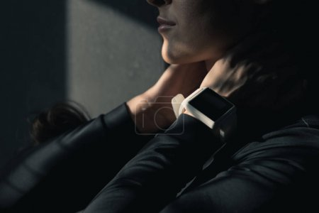 Young woman with smartwatch