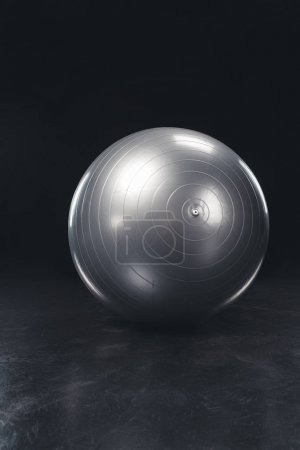 Photo for Shiny gray fitness ball on black background - Royalty Free Image