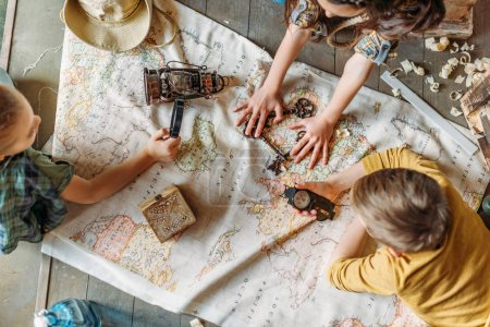 Little travelers with map