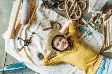 Boy lying on map
