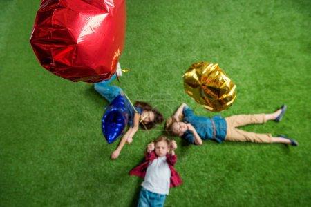 Children lying on grass
