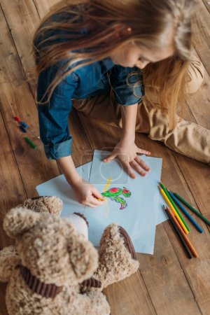 Photo for Little girl drawing picture on floor at home, kids drawing concept - Royalty Free Image