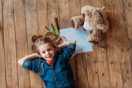 girl with toy and pencils