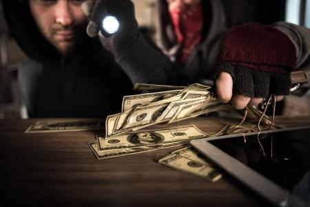 Robbers stealing money