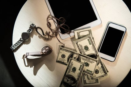 Money and valuables on table