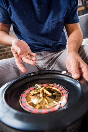 man with roulette wheel