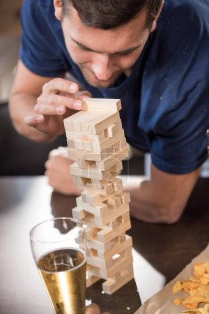 man playing jenga game