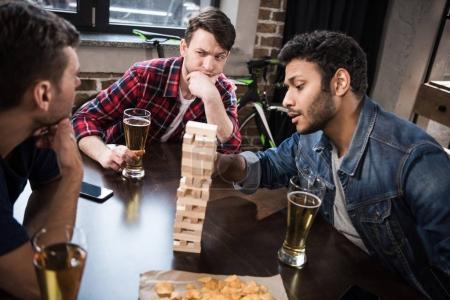 young people playing jenga game