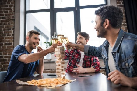 Photo for Diverse group of young people playing jenga game and drinking beer - Royalty Free Image