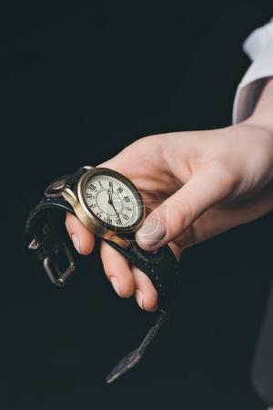 Female hand holding vintage watch