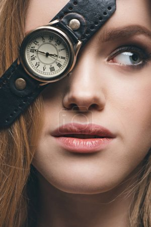Photo for Close-up portrait of blonde fashion girl hiding eye with vintage watch, studio shot - Royalty Free Image