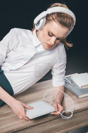 Blonde businesswoman in headphones