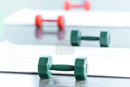Photo for Dumbbells on floor in gum, selective focus - Royalty Free Image
