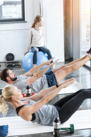 People doing gymnastics at fitness studio