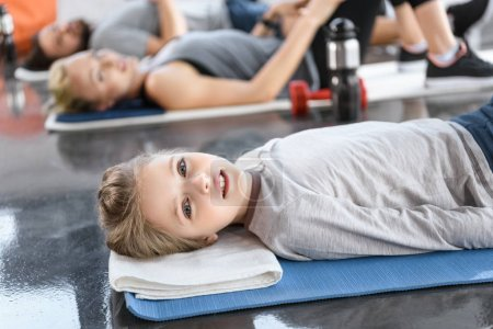 girl doing gymnastics at fitness studio