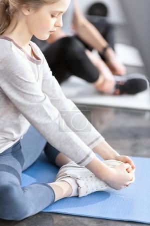 Girl doing gymnastics at fitness studio