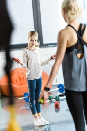 Photo for Young fitness people exercising with skipping ropes at sports center - Royalty Free Image