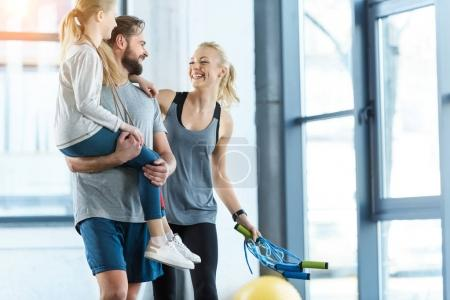 Photo for Portrait of happy family standing together at fitness center - Royalty Free Image