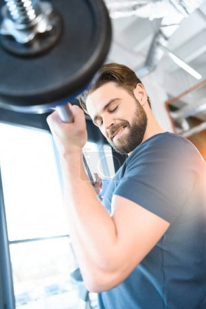 Photo for Handsome young guy workout with barbell - Royalty Free Image