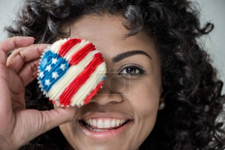 girl with american flag cupcake