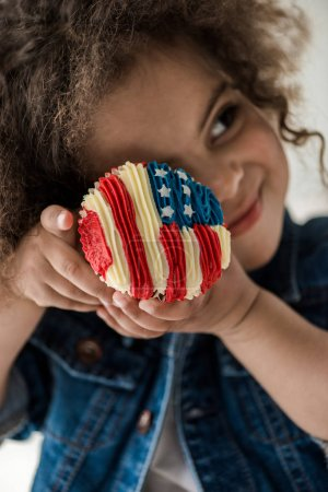 Girl with american flag muffin