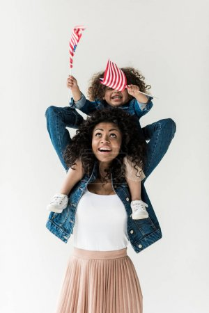 Daughter sitting on shoulders of mother