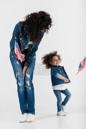 mother and daughter with american flags