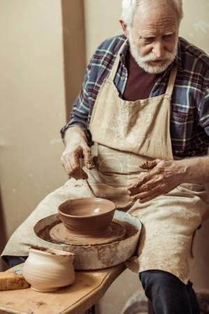 Photo for Close up of male craftsman working on potters wheel - Royalty Free Image